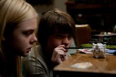 Left to right: Elle Fanning plays Alice Dainard and Joel Courtney plays Joe Lamb in SUPER 8, from Paramount Pictures.