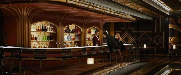 Jim et Aurora au bar du vaisseau avec Arthur le robot